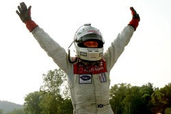 Race winner Allan McNish celebrates