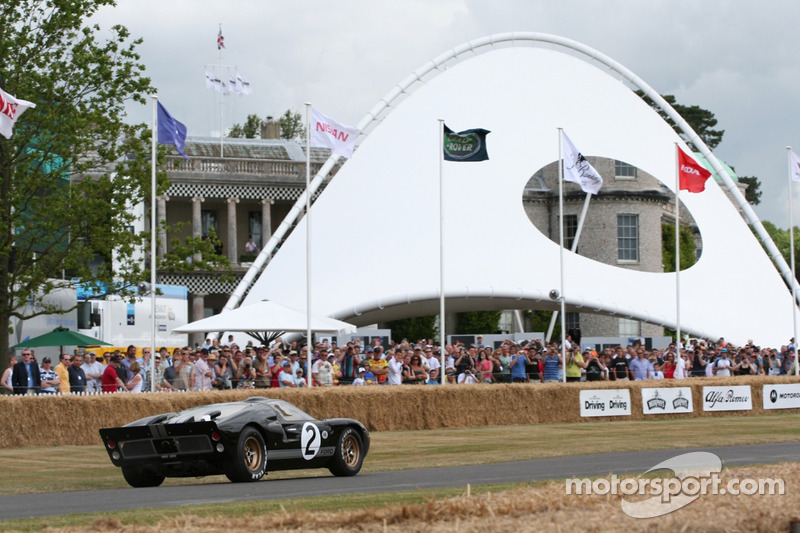 Ford GT40mkII Passes The Goodwood House - Jackie Oliver