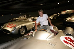 DaimlerChrysler Mercedes media warmup event: Kimi Raikkonen sits in a historical silver arrow at the Mercedes-Benz branch in Stuttgart