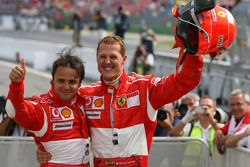 Race winner Michael Schumacher celebrates with Felipe Massa