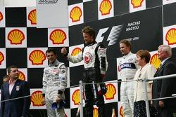 Podium: race winner Jenson Button with Pedro de la Rosa and Nick Heidfeld