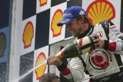 Podium: champagne for Jenson Button