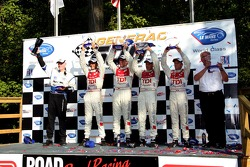 LMP1 podium: class and overal winner Frank Biela and Emanuele Pirro, with second place Rinaldo Capello and Allan McNish, and third place team owner Rob Dyson