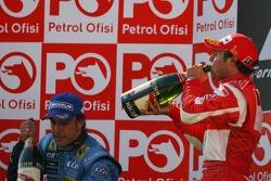 Podium: race winner Felipe Massa with Michael Schumacher
