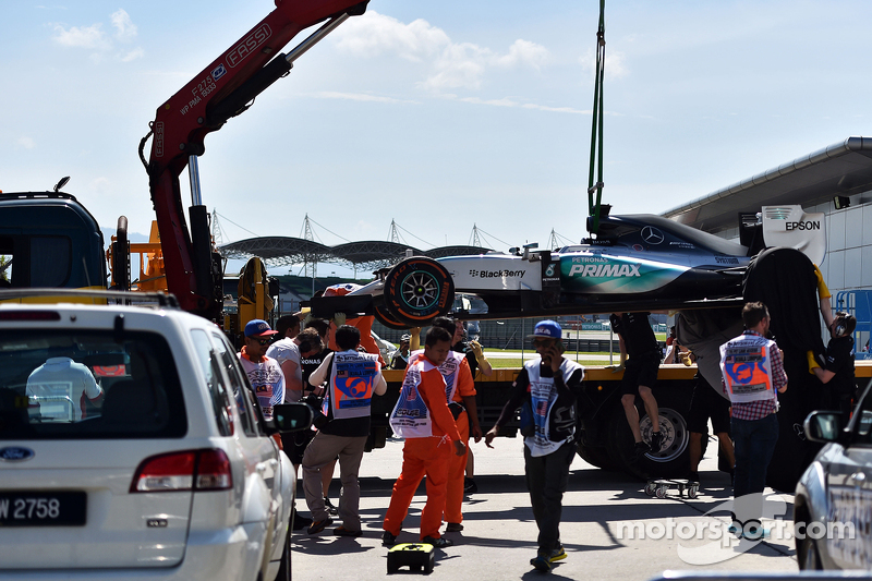 Mercedes AMG F1 W06 of Lewis Hamilton, Mercedes AMG F1 is recovered back to pits on back of a truck di first practice session