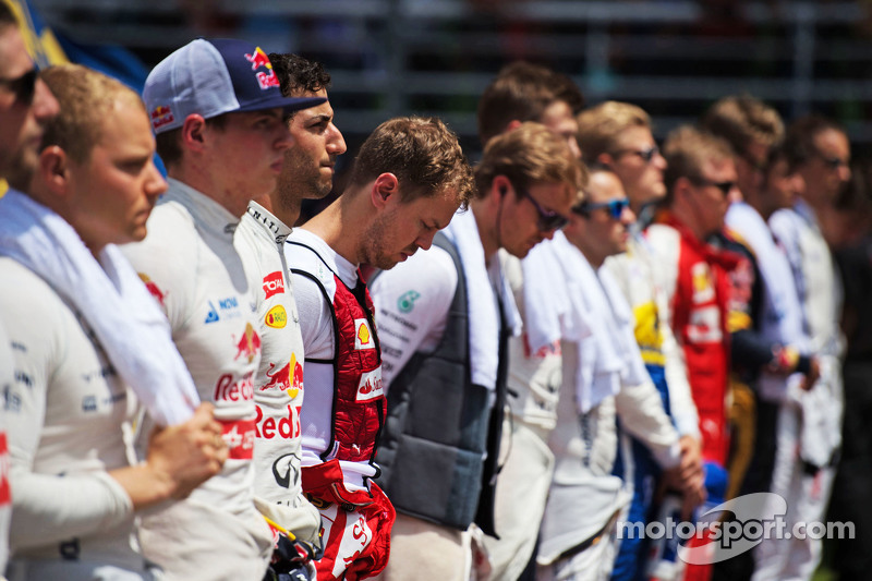 Sebastian Vettel, Ferrari bersama the drivers as the grid observes the national anthem