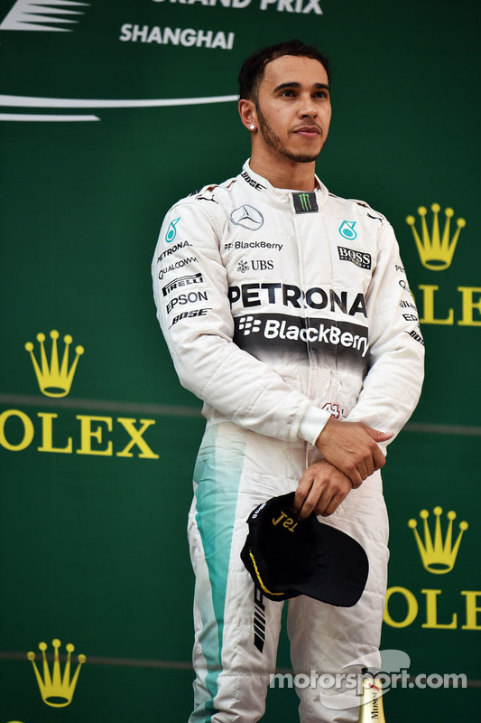Race winner Lewis Hamilton Mercedes AMG F1 on the podium