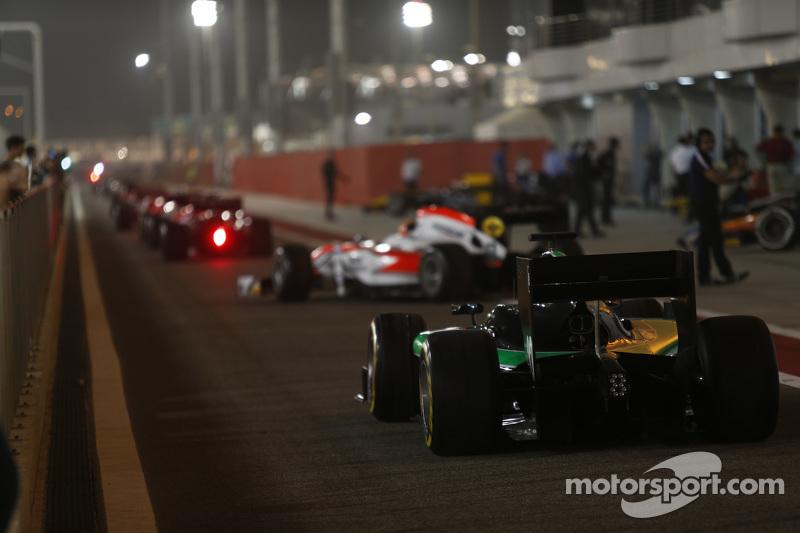 GP2 cars leave the GP2 pit lane