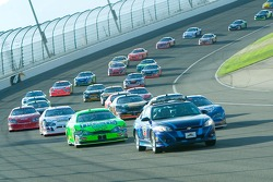Actor Jason Lee leads the field behind the wheel of the pace car