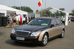 Bernie Ecclestone arrives at the circuit in his Mercedes Maybach