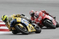 Valentino Rossi leads Loris Capirossi