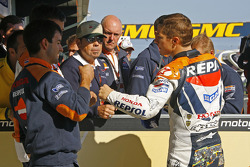 Pole winner Nicky Hayden celebrates
