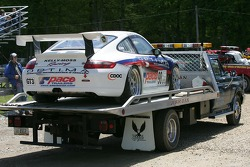 The car of Mitchell Bender back on a tow truck