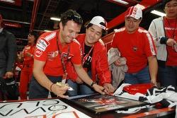 Loris Capirossi signs autographs