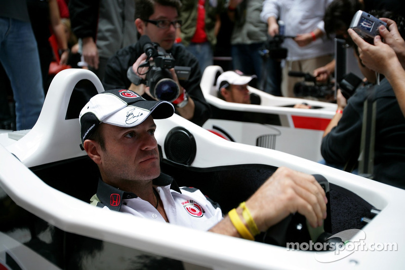Lucky Strike PR day: Jenson Button and Rubens Barrichello entertain the crowd on a simulator