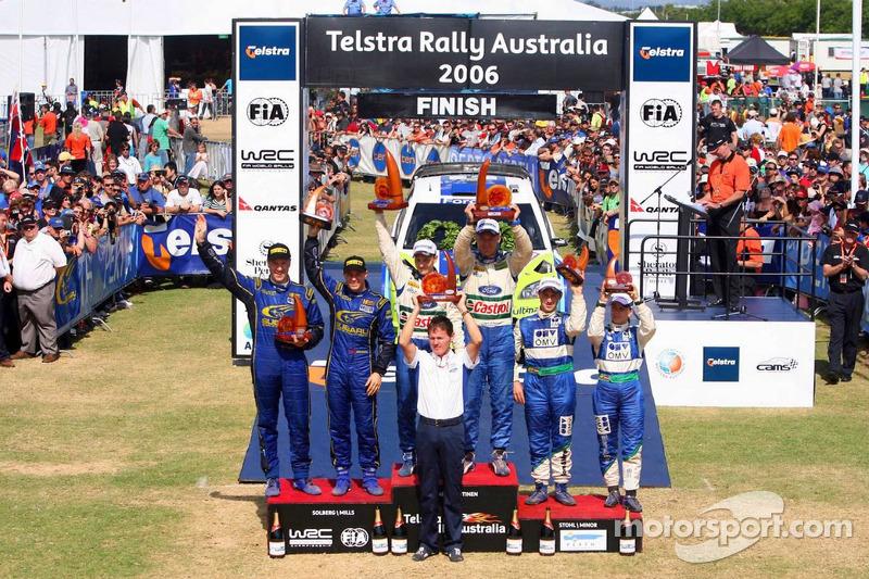 Podium : les vainqueurs Mikko Hirvonen et Jarmo Lehtinen, avec pour la deuxième place, Petter Solberg etPhil Mills, et Manfred Stohl et Ilka Minor pour la troisième place