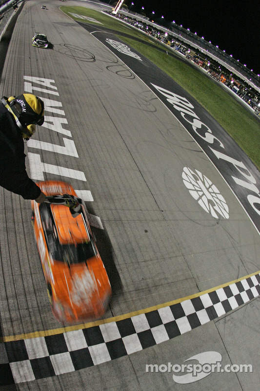 Tony Stewart takes the checkered flag