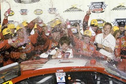 Kasey Kahne is greeted by his crew in Victory Lane