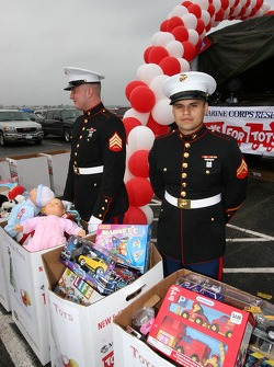 Marines accept toy donations during the Toys for Tots annual holiday campaign kickoff