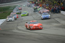 Tony Stewart leads the field off of pit road after pit stops