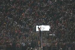 Tony Stewart climb into the flag stand