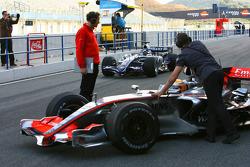 Alexander Wurz passes Lewis Hamilton