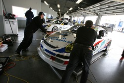 Synergy Racing crew members at work