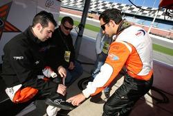 Sam Hornish Jr. and Helio Castroneves have a conversation about shoes