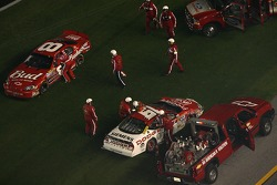 Dale Earnhardt Jr. and Elliott Sadler have a discussion while the safety crew works on the wreck