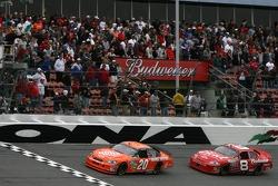Tony Stewart leads Dale Earnhardt Jr. on a late restart