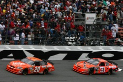 Tony Stewart leads Jeff Burton
