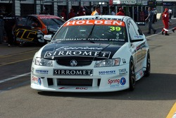 Newcomer Fabian Coulthard rolls down pit lane
