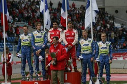 Podium: winners Sébastien Loeb and Daniel Elena, second place Marcus Gronholm and Timo Rautianen, third place Mikko Hirvonen and Jarmo Lehtinen
