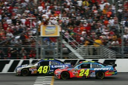 Jimmie Johnson crosses the finish line ahead of Jeff Gordon