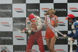 Podium: race winner Sébastien Bourdais and Oriol Servia spray champagne