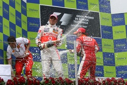Podium: champagne for Lewis Hamilton and Felipe Massa