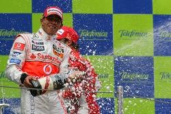 Podium: champagne for Lewis Hamilton
