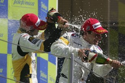 Timo Glock celebrates victory with Javier Villa and Lucas di Grassi
