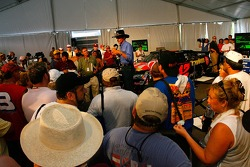 Former NASCAR driver Richard Petty, speaks at the Evolution of a Stock Car display