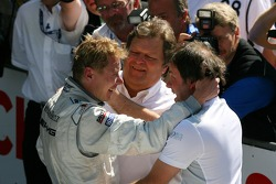 Race winner Mika Hakkinen, Team HWA AMG Mercedes, being congratullated by Gerhard Ungar, Chief Designer AMG and Norbert Haug, Sporting Director Mercedes-Benz