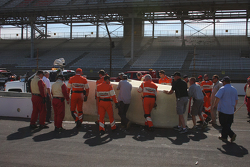 Workers replace the pitwall barrier after Pippa Mann's crash
