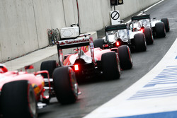 Nico Rosberg, Mercedes AMG F1 W06; Lewis Hamilton, Mercedes AMG F1 W06; Sebastian Vettel, Ferrari SF15-T; and Kimi Raikkonen, Ferrari SF15-T at the end of the pit lane