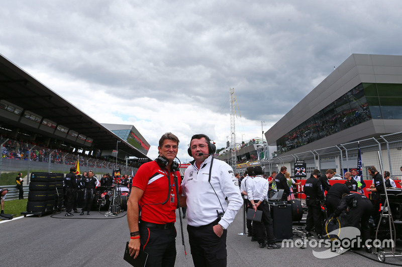 Graeme Lowdon, Manor F1 Team Chief Executive Officer with Eric Boullier, McLaren Racing Director on the grid