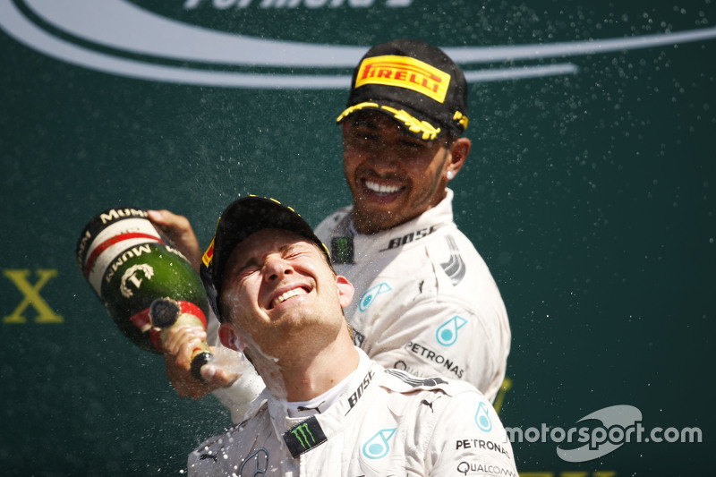 Race winner Lewis Hamilton, Mercedes AMG F1 celebrates on the podium with team mate Nico Rosberg, Mercedes AMG F2