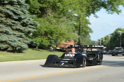 Race cars parade into Elkhart Lake для concours  1974 Shadow DN4