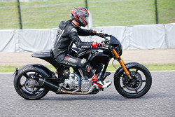 Keanu Reeves rides his motorcycle around Suzuka
