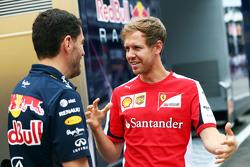 Sebastian Vettel, Ferrari with Guillaume Rocquelin, Red Bull Racing Head of Race Engineering