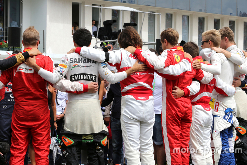 Drivers during minute of silence for Jules Bianchi