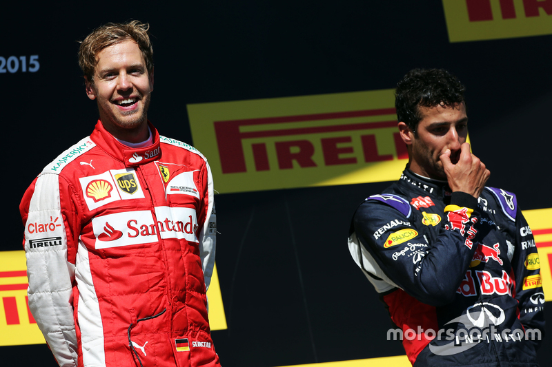 Race winner Sebastian Vettel, Ferrari celebrates on the podium with Daniel Ricciardo, Red Bull Racing