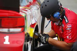 Chip Ganassi Racing mechanic checks tire pressures